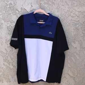 A men's Blue, Black, and white Lacoste Sport Polo